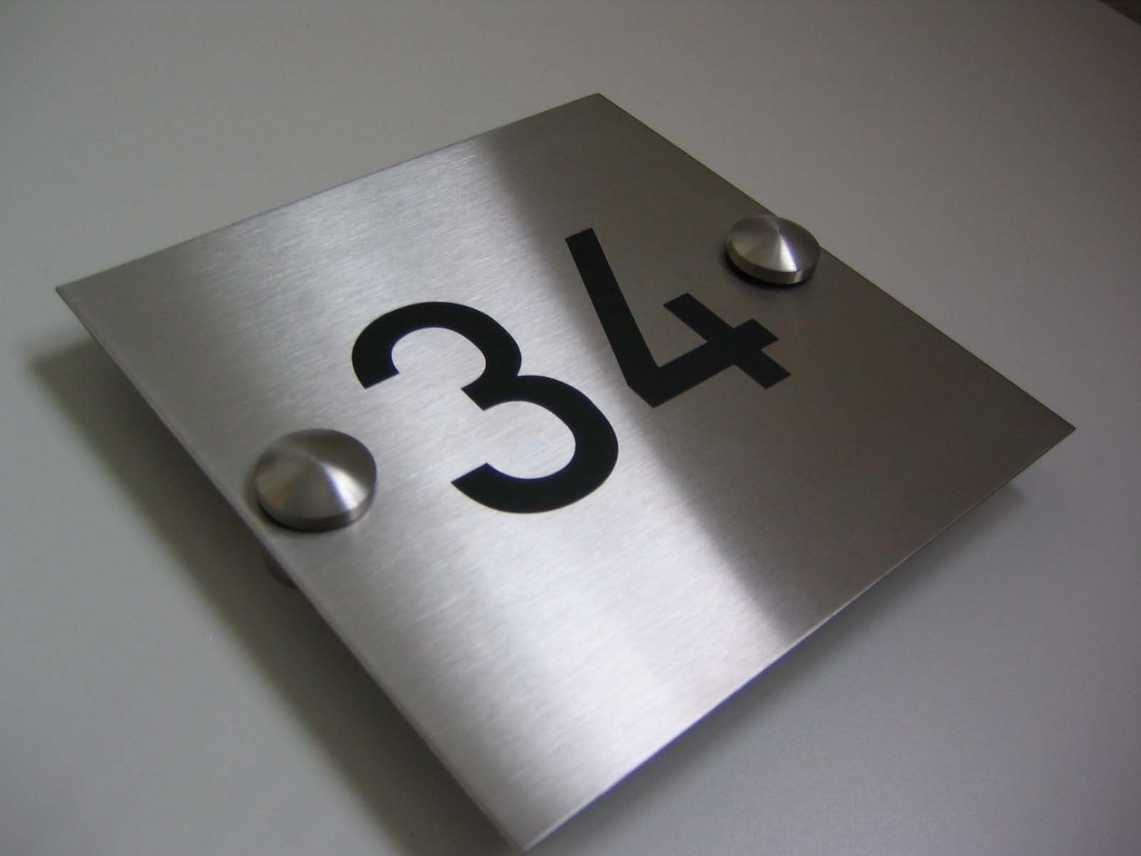 brushed stainless sign